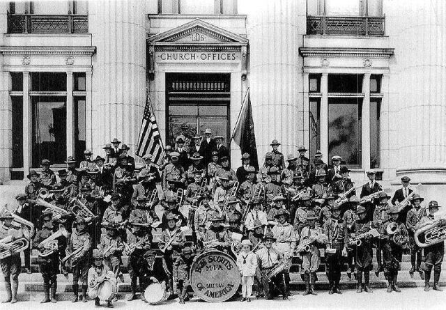 """LDS Boy Scouts infront of the Church Offices, the drum saying """"Boy Scouts of America, Salt Lake, MIA"""" (Mutual Improvement Association)."""