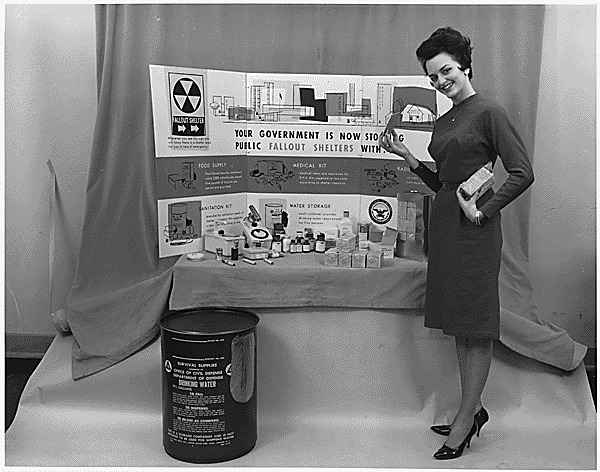 Photograph of a display of survival supplies for the well-stocked fallout shelter, ca.1961.