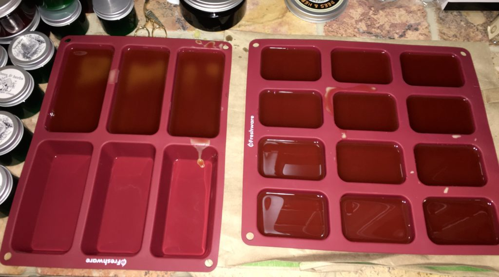 melted beeswax in silicone molds